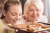 Fotografie Grandmother and grandchild with cookies