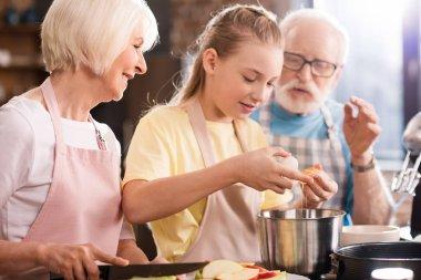 Family baking apple pie