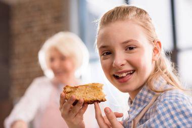 girl eating homemade pie