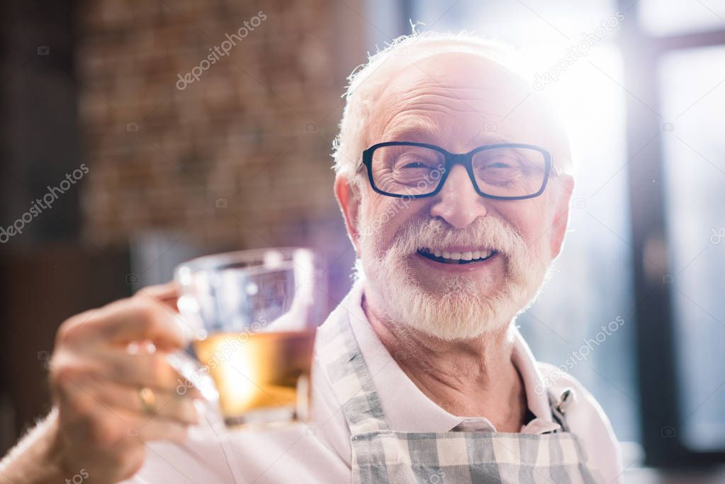 senior man with cut of tea