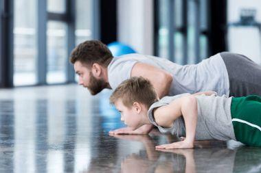 Man and boy doing push ups