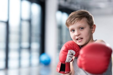 boy boxer in red boxing gloves