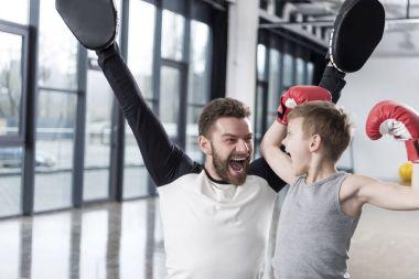 boy boxer with his coach