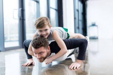 Man doing push ups with boy