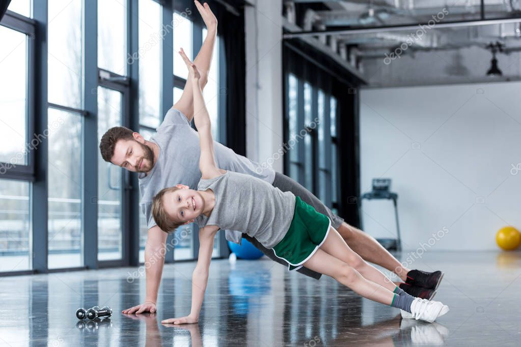 Man and boy doing plank exercise