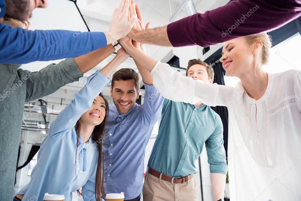 businesspeople giving highfive