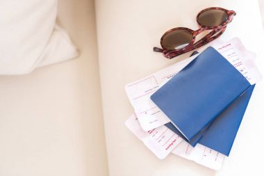 Passports with tickets and sunglasses
