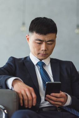 asian businessman using smartphone