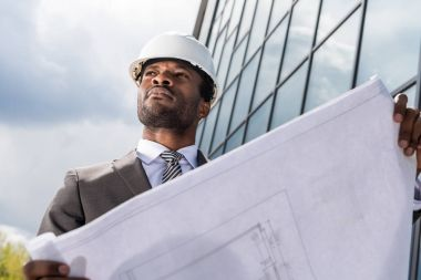 Professional architect in hard hat
