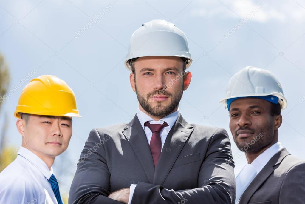 professional architects in hard hats