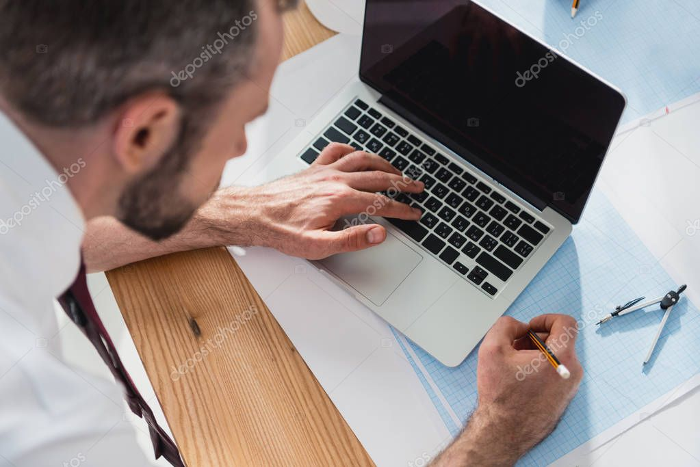 professional architect working with laptop