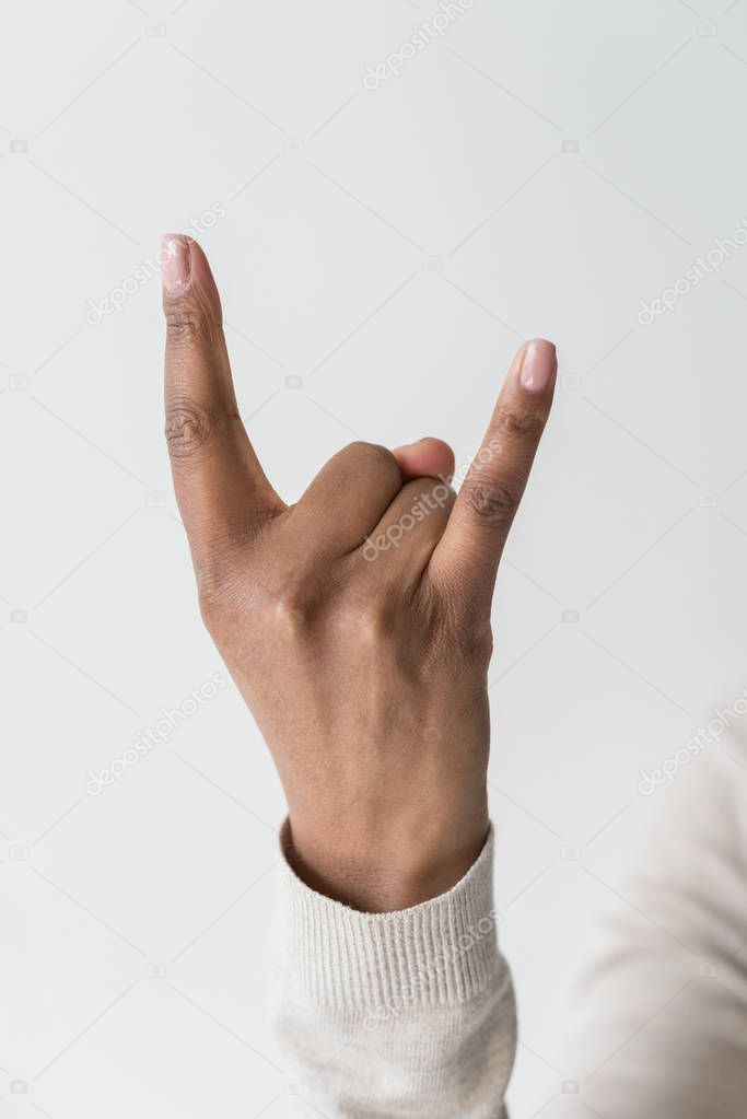 woman showing rock sign