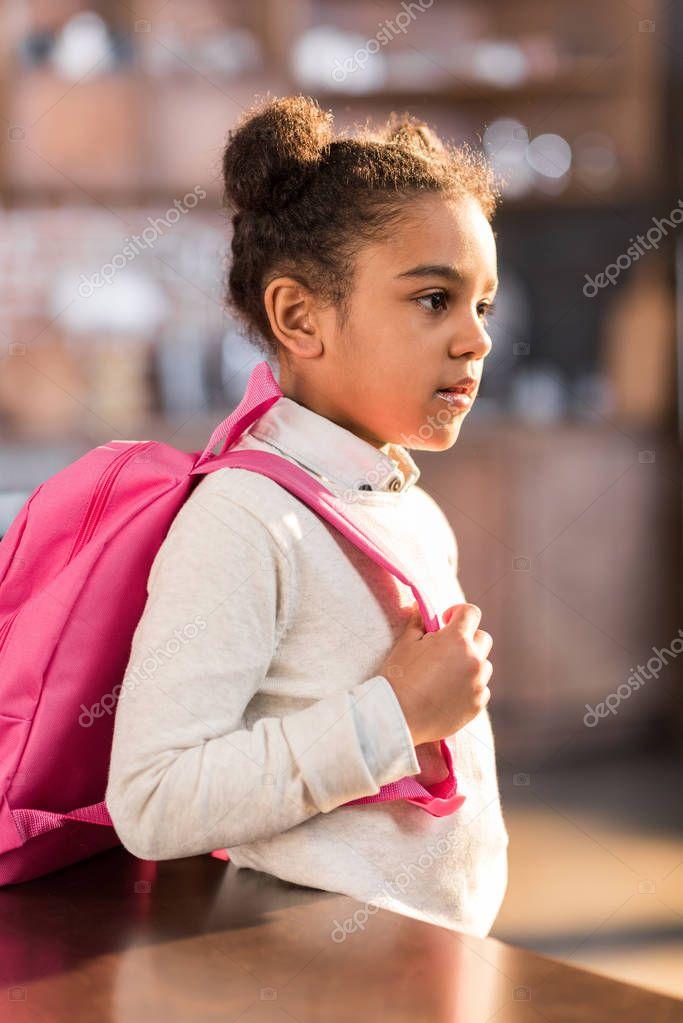 schoolgirl preparing for school