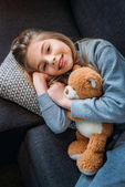 Photo Little girl with teddy bear