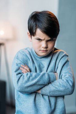 offended boy with crossed arms