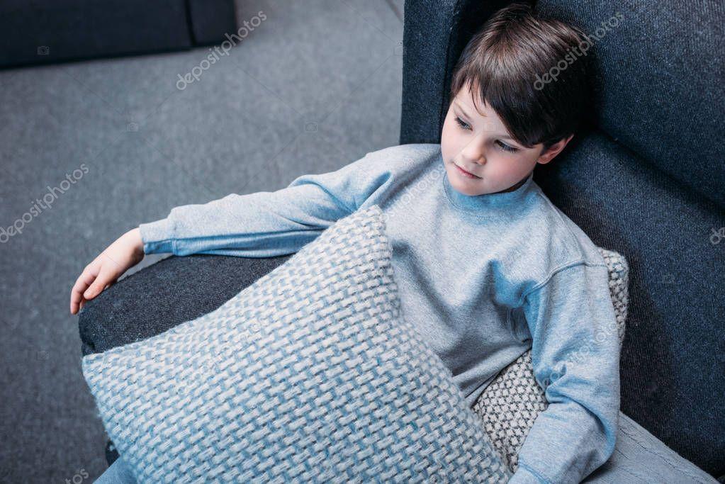 Boy in pajamas on sofa