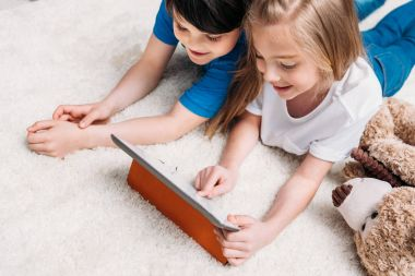 little boy and girl with digital tablet