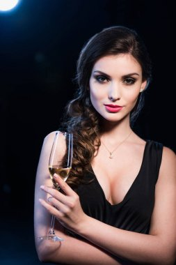 Stylish woman drinking champagne