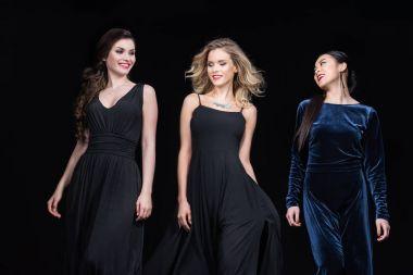 women in stylish maxi dresses