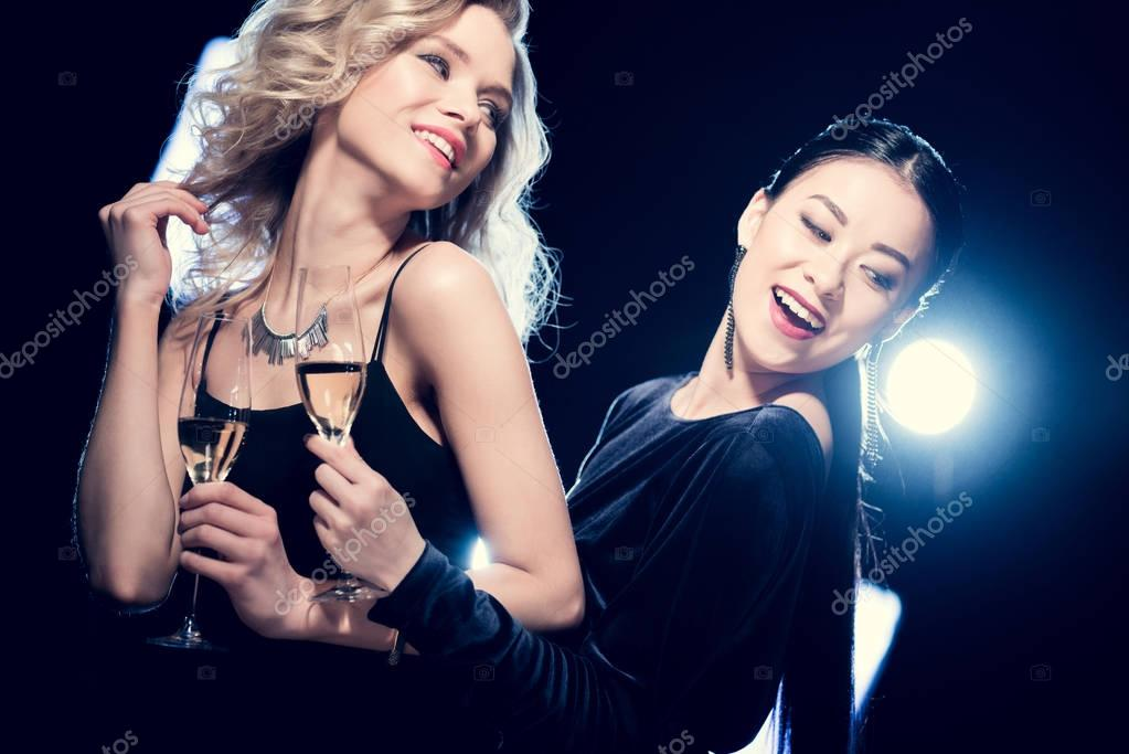Multicultural glamour girls with champagne 4