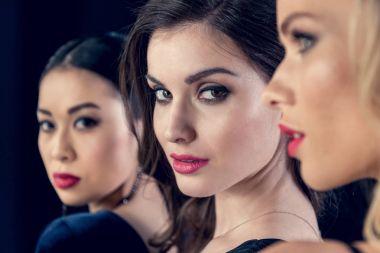 beautiful women looking at camera