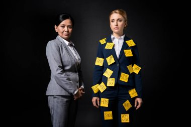 Stressed businesswoman with colleague