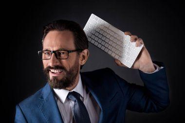 Bearded businessman with keyboard