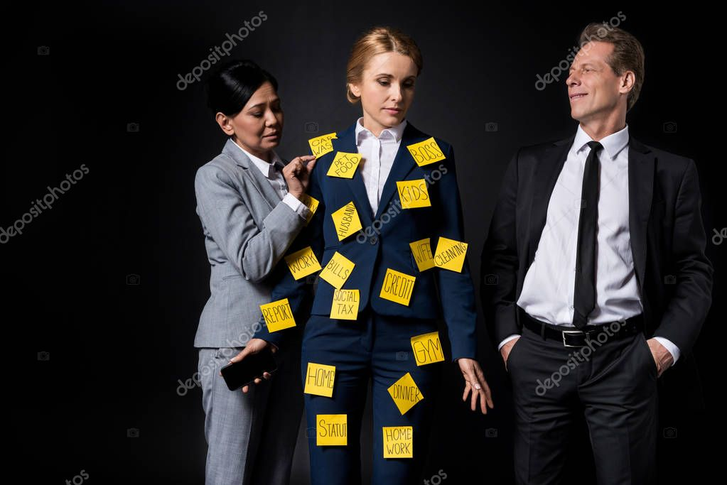 stressed businesswoman with colleagues
