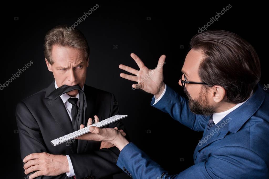 mature businessmen quarreling