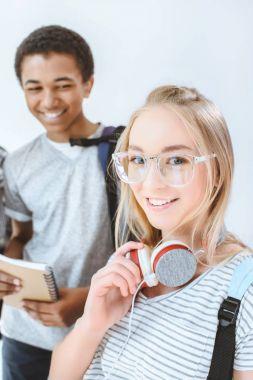 multiethnic smiling teenagers