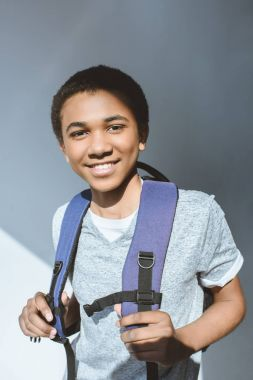 African american teenage boy with backpack