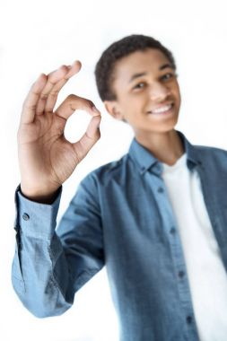 African american teenager showing ok sign