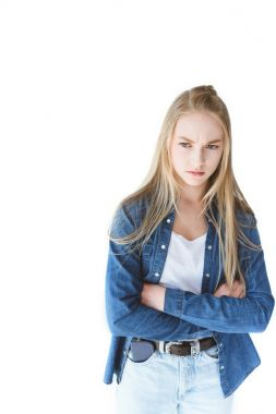 Grumpy teenage girl with arms crossed