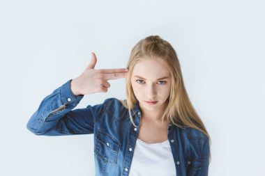 teenager with hand near head