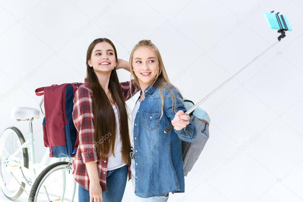 happy teenagers taking selfie together