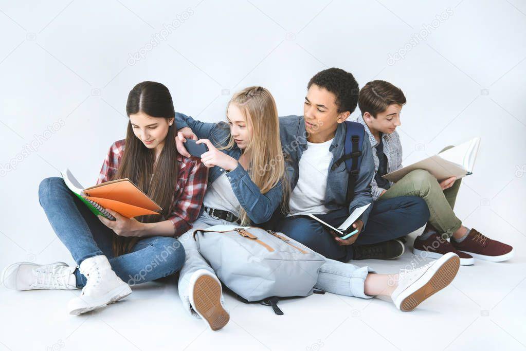 multicultural students doing homework