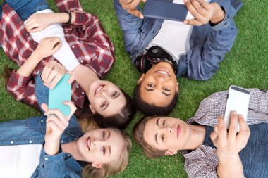 Multiethnic teenagers with smartphones