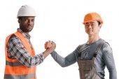 tým z afro-americké a asijské stavební dělníci