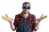 Fotografie pracovník v oblasti svařování brýle a rukavice