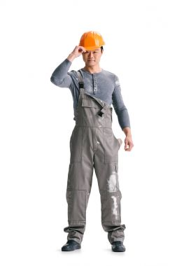 Construction worker in overall and helmet