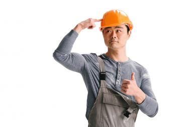 construction worker ponting at helmet