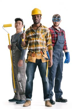 Group of multiethnic construction workers with tools stock vector