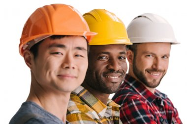 Group of multiethnic construction workers in row looking at camera stock vector