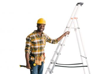 handsome construction worker with ladder