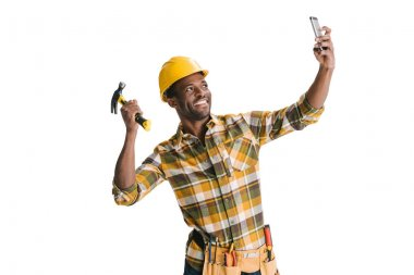 Handsome african-american builder taking selfie isolated on white stock vector