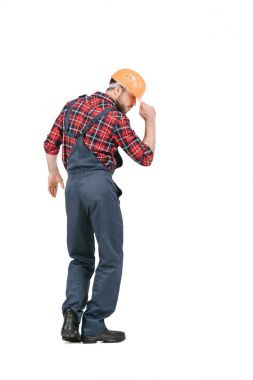 construction worker dancing in overall and hardhat