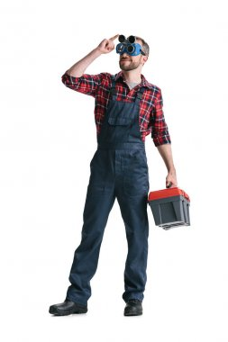 Young handsome construction worker with toolbox isolated on white stock vector