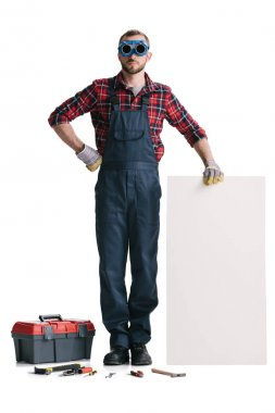 Handsome construction worker with blank banner and toolbox isolated on white stock vector