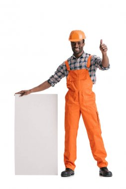 African-american builder with blank white banner shoing thumb up isolated on white stock vector