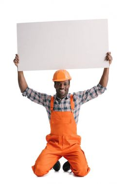 African-american builder with blank white banner over head isolated on white stock vector